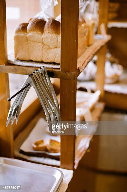 Tongs hanged in neighbor bakery