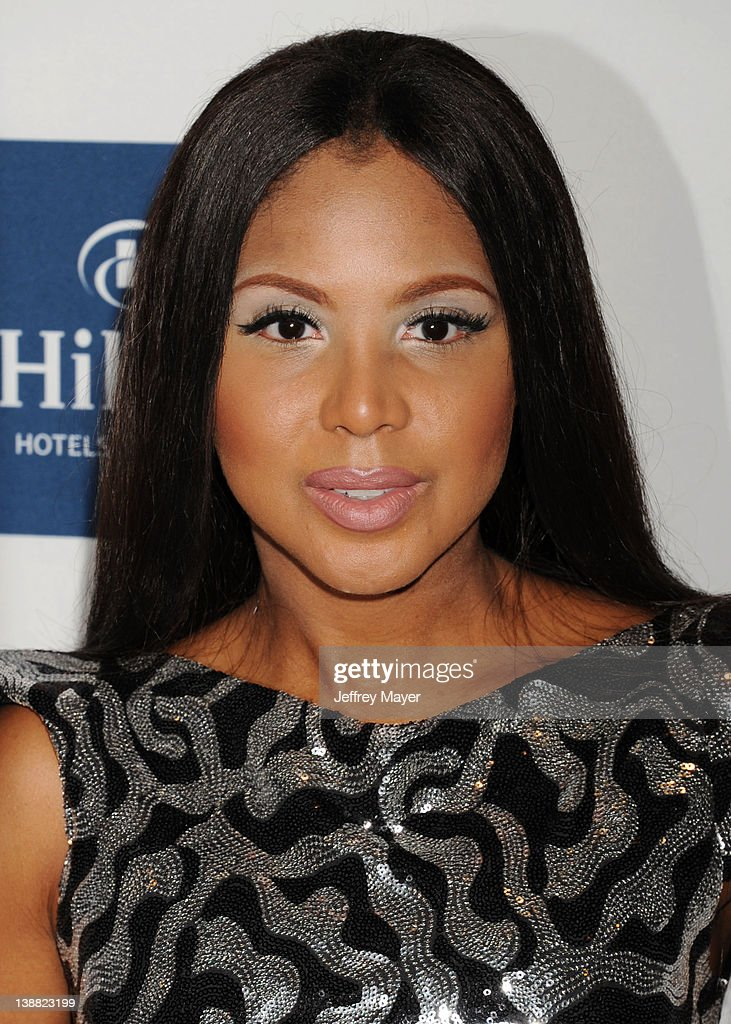 Toni Braxton arrives at the Clive Davis and The Recording Academy's 2012 Pre-GRAMMY Gala and Salute to Industry Icons Honoring Richard Branson at The Beverly Hilton hotel on February 11, 2012 in Beverly Hills, California.