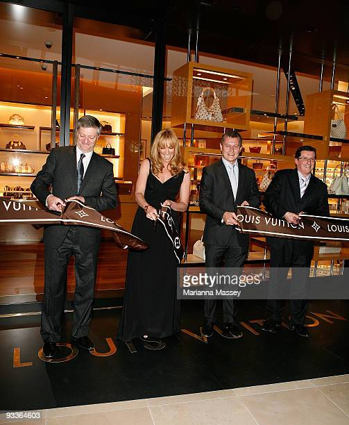Toni Collette cuts the ribbon for the official opening of the new Louis Vuitton store at the Chadstone Shopping Centre along with Jean Baptiste...