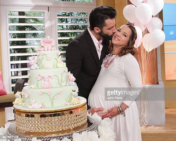 Toni Costa and Adamari Lopez pose during their baby shower at Telemundo Studio on February 6 2015 in Miami Florida
