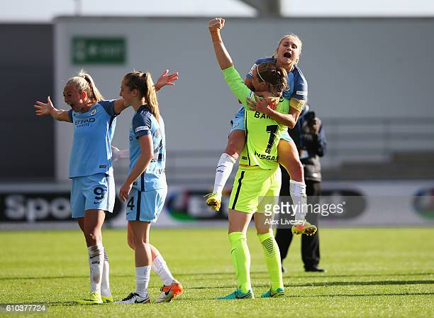 Toni Duggan Keira Walsh Steph Houghton and Karen Bardsley of Manchester City Women celebrate as they win the WSL title after the WSL 1 match between...