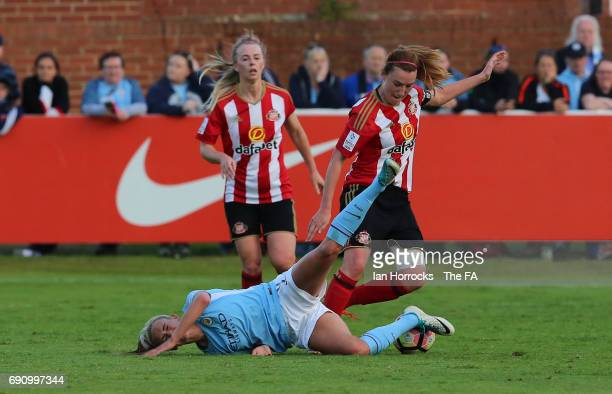 Toni Duggan of City is brought down by Steph Bannon during the FA WSL Spring Series match between Sunderland AFC Ladies and Manchester City Women at...