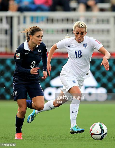 Toni Duggan of England and Laure Boulleau of France fight for the ball during the FIFA Women's World Cup 2015 Group F match at Moncton Stadium on...