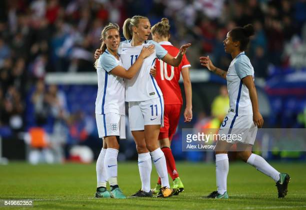 Toni Duggan of England celebrates with Jordan Nobbs and Nikita Parris after scoring the fifth goal during the FIFA Women's World Cup Qualifier...