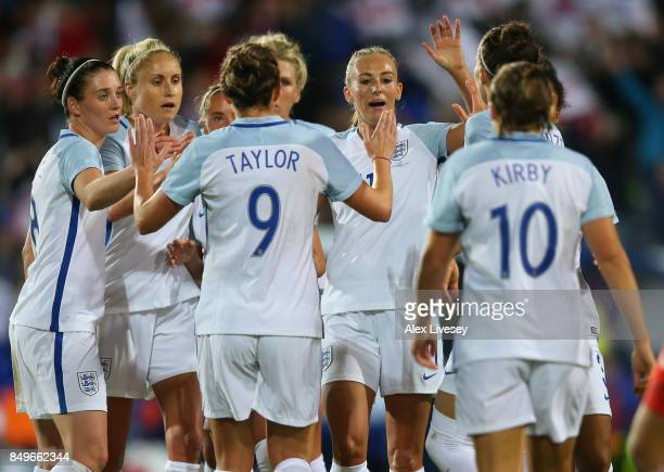 Toni Duggan of England celebrates with team mates after scoring the fifth goal during the FIFA Women's World Cup Qualifier between England and Russia...