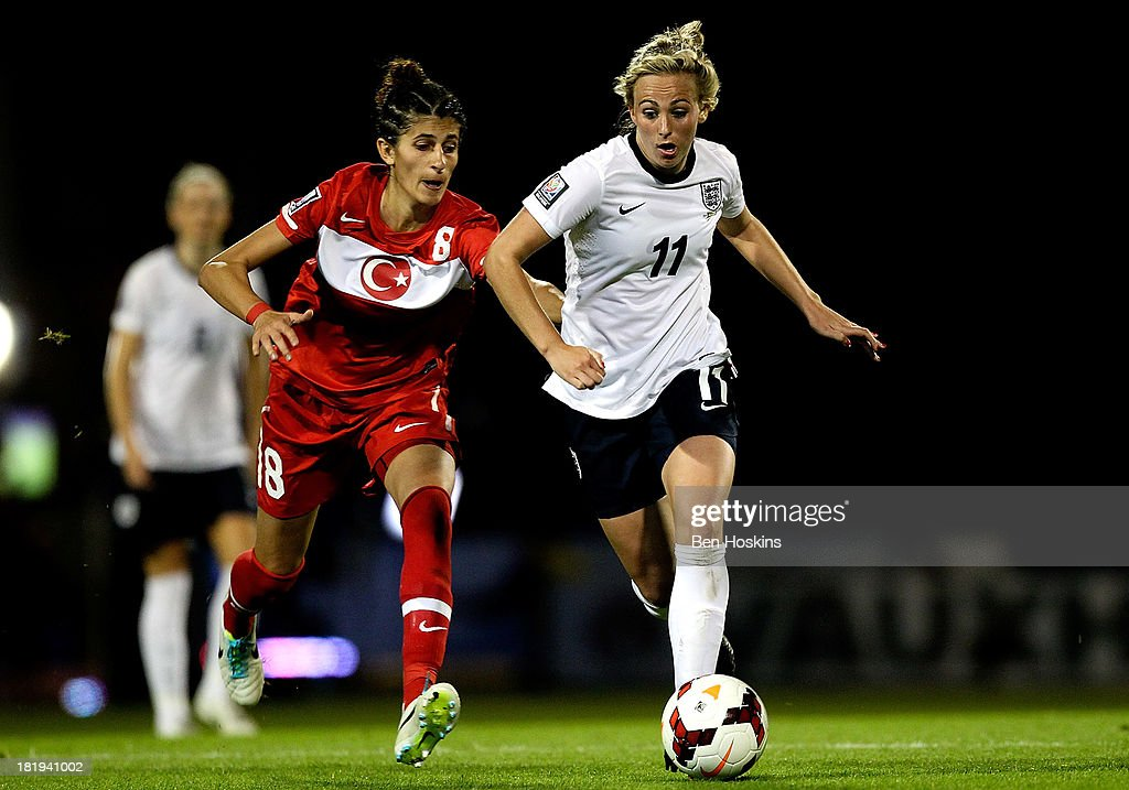 Toni Duggan (R) of England holds off pressure from Yagmur Uraz of Turkey during the FIFA Women's World Cup 2015 Group 6 Qualifier match between England and Turkey at Fratton Park on September 26, 2013 in Portsmouth, England.