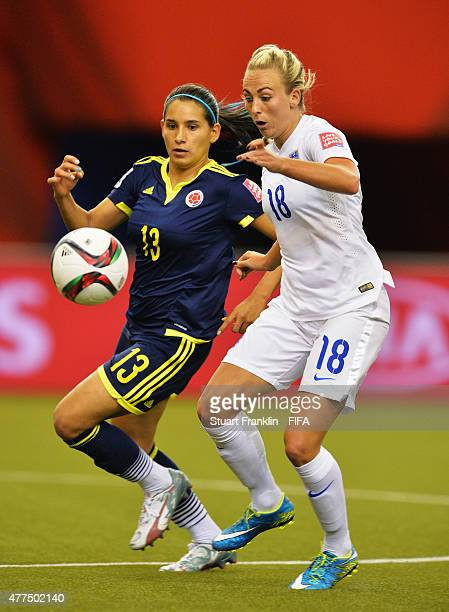Toni Duggan of England is challenged by Angela Clavijo of Colombia during the FIFA Womens's World Cup Group F match between England and Colombia at...