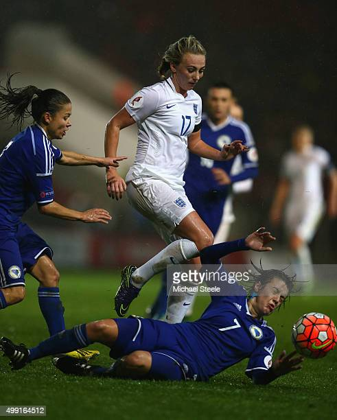 Toni Duggan of England is tackled by Andela Seslija of Bosnia and Herzegovina during the UEFA Women's Euro 2017 Qualifier match between England and...