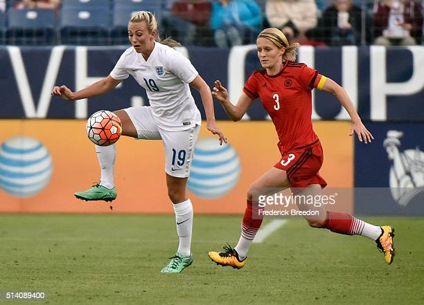 Toni Duggan of England kicks the ball away from Saskia Bartusiak of Germany during the first half of a friend international match of the Shebelieves...