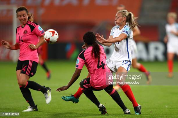 Toni Duggan of England looks to avoid the tackle from Scotland's Ifeoma Dieke during the UEFA Women's Euro 2017 Group D match between England and...