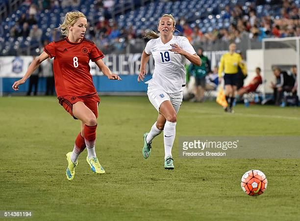 Toni Duggan of England plays against Kathrin Hendrich of Germany in a friendly international match in the Shebelieves Cup at Nissan Stadium on March...