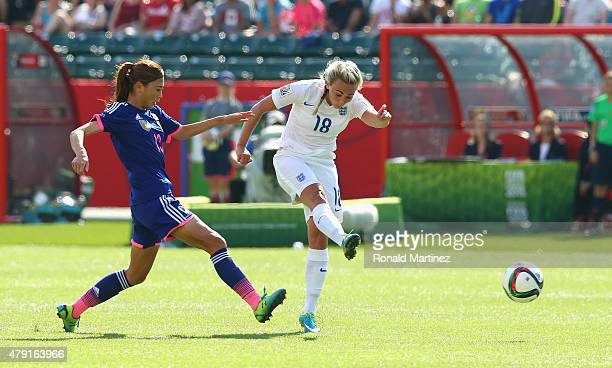 Toni Duggan of England shoots past Rumi Utsugi of Japan during the FIFA Women's World Cup Semi Final match between Japan and England at the...