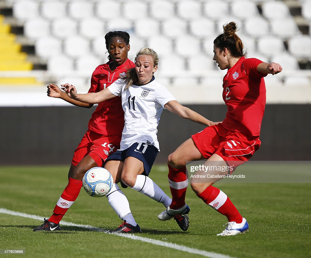 Toni Duggan (C) of England tries to get past Emily Zurrer (R) and Kasiesha Buchanan (L) of Canada during the Cyprus Cup match between England and Canada at GSP stadium on March 10, 2014 in Nicosia, Cyprus.