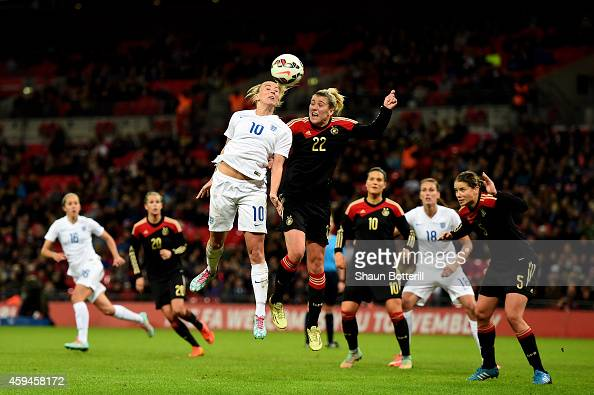 Toni Duggan of England wins a header under pressure from Luise Wensing of Germany during the Women's International Friendly match between England and...