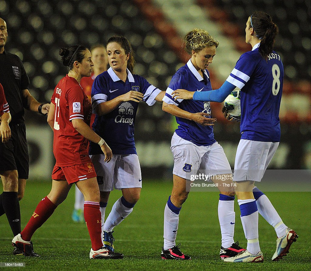 Toni Duggan of Everton Ladies FC is restrained by Jill Scott and teammates after clashing with Nicole Rolser of Liverpool Ladies FC during the FA WSL...