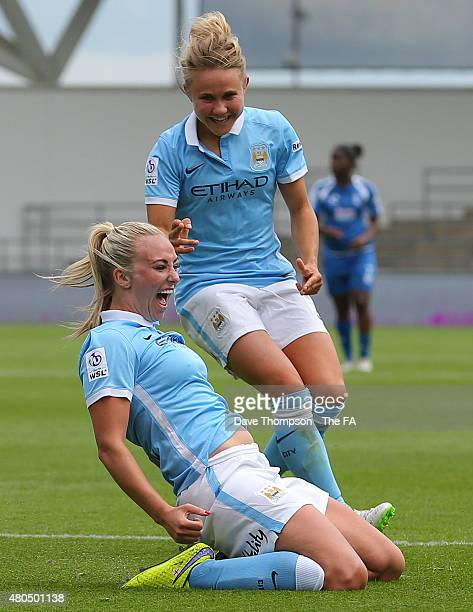 Toni Duggan of Manchester City celebrates with Isobel Christiansen after scoring against Birmingham City during the Women's Super League match...
