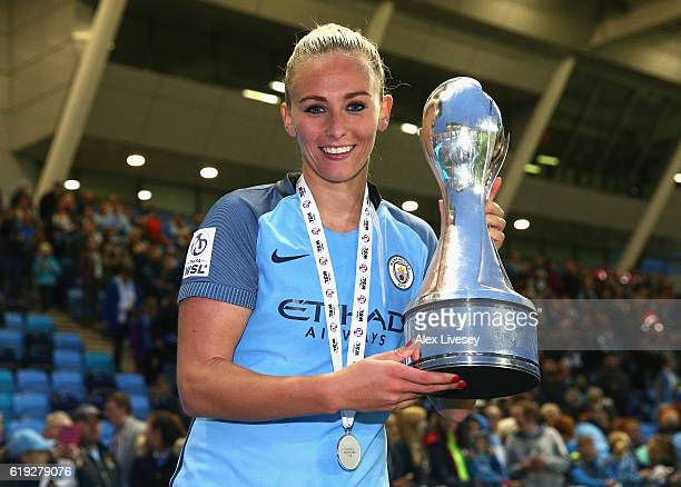 Toni Duggan of Manchester City celebrates with the Women's Super Leage 1 trophy after the final whistle during Women's Super League1 match between...