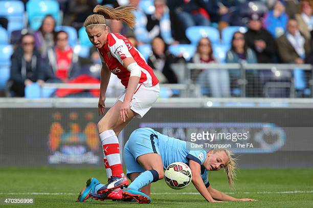 Toni Duggan of Manchester City tackles Leah Williamson of Arsenal during the Women's Super League match match between Manchester City and Arsenal at...