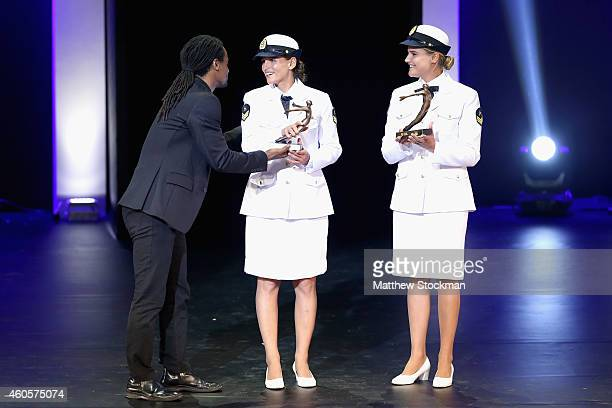 Toni Garrido presents Martine Grael and Kahena Kunze with the Sailing's Athlete of the Year Trophy during the Brazil Olympics Awards Ceremony at...