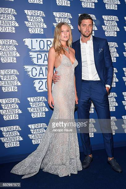 Toni Garrn and Chandler Parson attend the L'Oreal Paris Blue Obsession Party during the 69th annual Cannes Film Festival on May 18 2016 in Cannes...