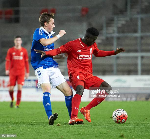Toni Gomes of Liverpool and Ben Morris of Ipswich Town in action during the Liverpool v Ipswich Town FA Youth Cup game at Langtree Park on December...