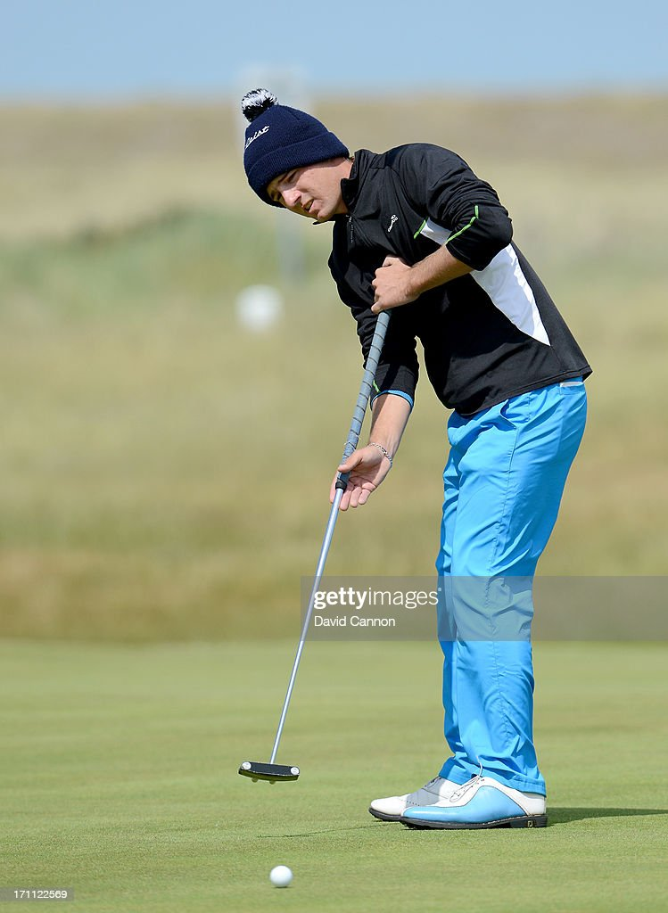 Toni Hakula of Finland putting on the 11th hole during the afternoon round in the final of the 2013 Amateur Championship at Royal Cinque Ports Golf Club on June 22, 2013 in Deal, England.