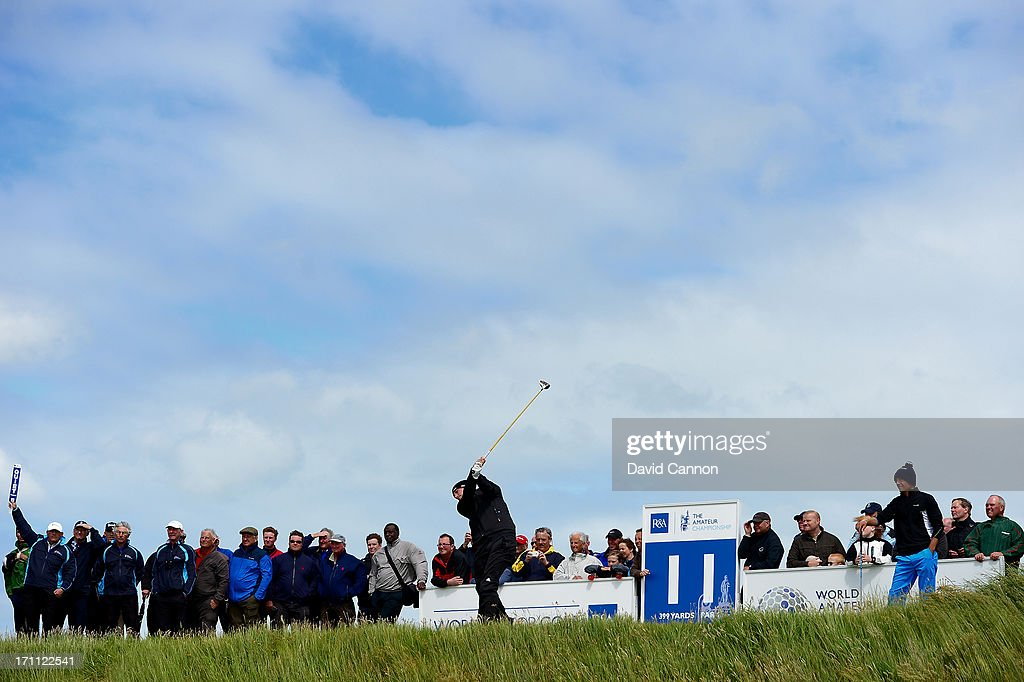 Toni Hakula of Finland watches his opponent Garrick Porteous of England play his tee shot on the 11th hole during the afternoon round in the final of the 2013 Amateur Championship at Royal Cinque Ports Golf Club on June 22, 2013 in Deal, England.