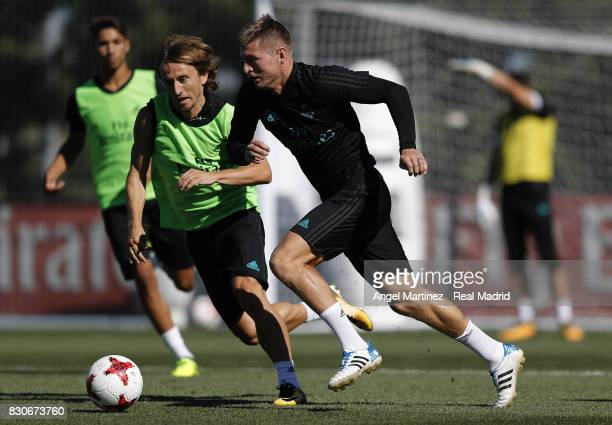 Toni Kroos and Luka Modric of Real Madrid in action during a training session at Valdebebas training ground on August 12 2017 in Madrid Spain