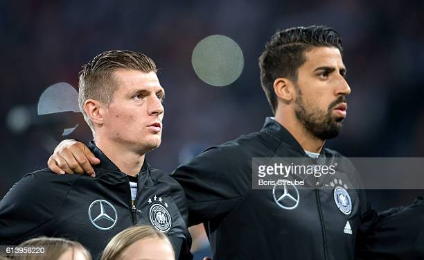 Toni Kroos and Sami Khedira of Germany sing the national anthem prior to the FIFA World Cup 2018 qualifying match between Germany and Czech Republic...
