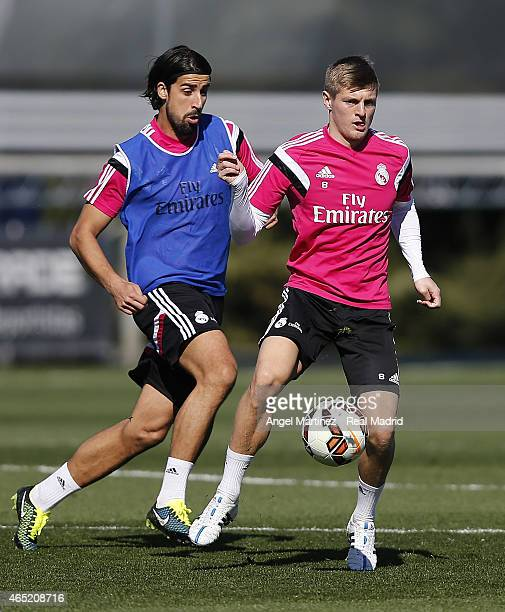 Toni Kroos and Sami Khedira of Real Madrid in action during a training session at Valdebebas training ground on March 4 2015 in Madrid Spain
