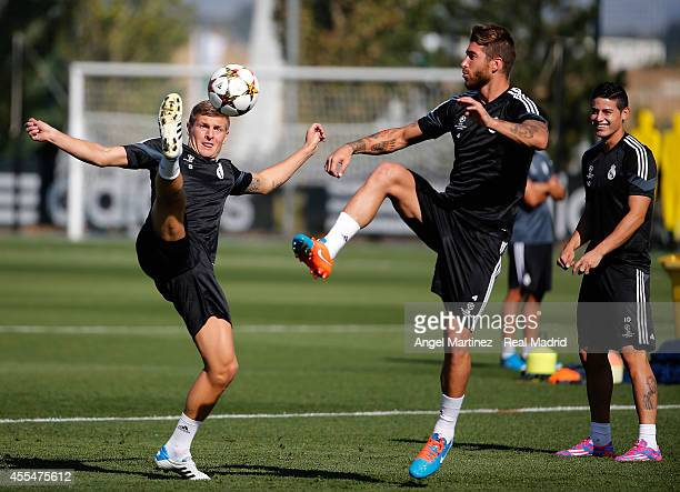 Toni Kroos and Sergio Ramos of Real Madrid in action during a training session ahead of their UEFA Champions League Group B match against Basilea at...