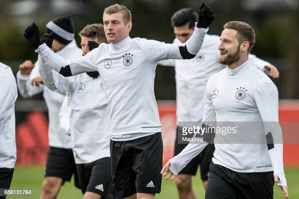 Toni Kroos and Shkodran Mustafi warm up during training of the German national team ahead of the international friendly match against England at on...
