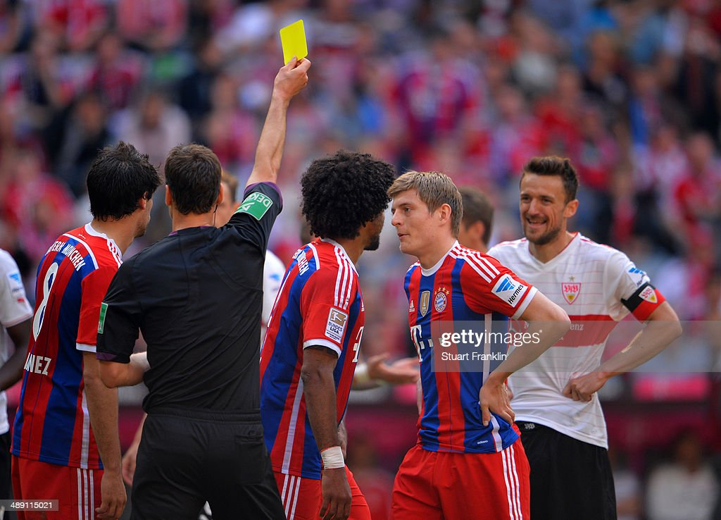 Toni Kroos (2R) appeals to referee Bastian Dankert as he shows a yellow card during the Bundesliga match between Bayern Muenchen and VfB Stuttgart at Allianz Arena on May 10, 2014 in Munich, Germany.