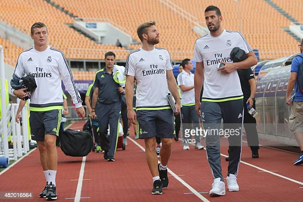 Toni Kroos Asier Illarramendi and Kiko Casilla of Real Madrid arrive at Tianhe Sports Center prior to a training session ahead of the International...