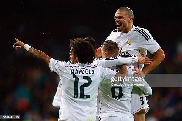 Toni Kroos celebrates scoring their third goal with teammates Pepe and Marcelo during the La Liga match between Real Madrid CF and Rayo Vallecano de...
