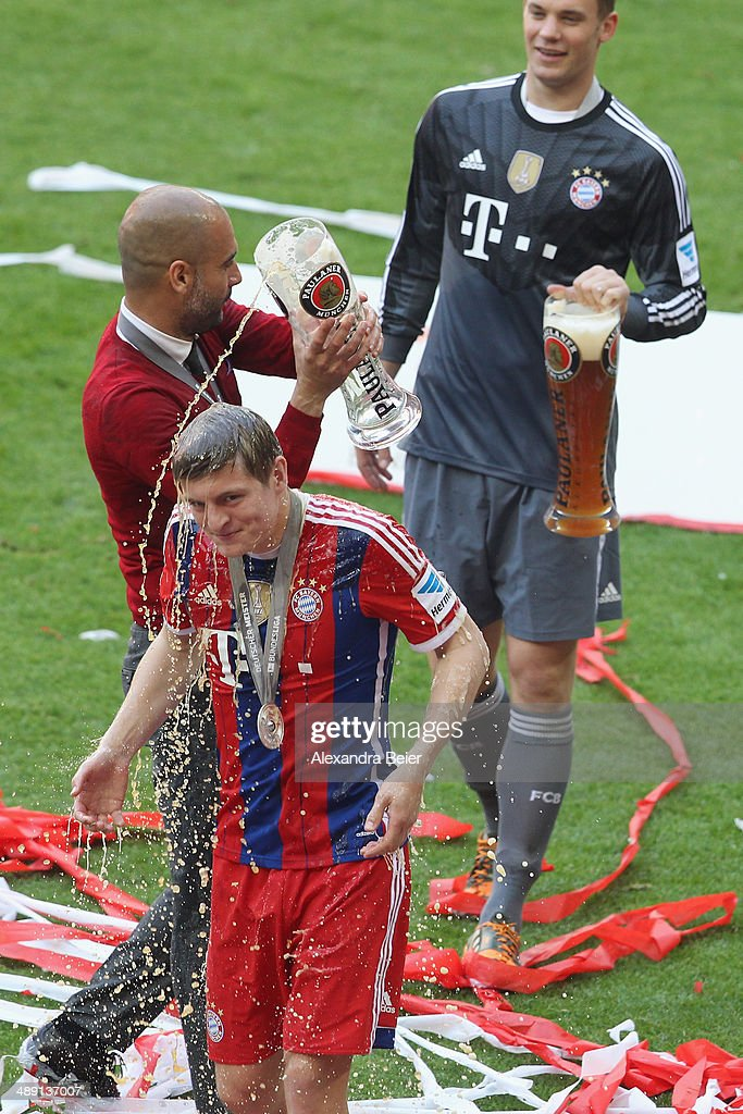 <a gi-track='captionPersonalityLinkClicked' href=/galleries/search?phrase=Toni+Kroos&family=editorial&specificpeople=638597 ng-click='$event.stopPropagation()'>Toni Kroos</a> is showered with beer by head coach <a gi-track='captionPersonalityLinkClicked' href=/galleries/search?phrase=Josep+Guardiola&family=editorial&specificpeople=2088964 ng-click='$event.stopPropagation()'>Josep Guardiola</a> of Bayern Muenchen while <a gi-track='captionPersonalityLinkClicked' href=/galleries/search?phrase=Manuel+Neuer&family=editorial&specificpeople=764621 ng-click='$event.stopPropagation()'>Manuel Neuer</a> looks on to celebrate winning the German Championship after the Bundesliga match between FC Bayern Muenchen and VfB Stuttgart at Allianz Arena on May 10, 2014 in Munich, Germany.