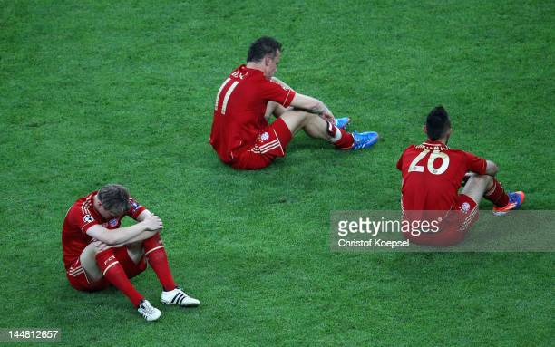 Toni Kroos Ivica Olic and Diego Contento of Bayern look dejected after their defeat in the UEFA Champions League Final between FC Bayern Muenchen and...