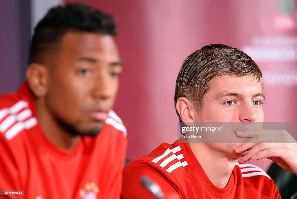 Toni Kroos looks on next to Jerome Boateng during a Bayern Muenchen press conference for the FIFA Club World Cup at Agadir Stadium on December 16, 2013 in Agadir, Morocco.