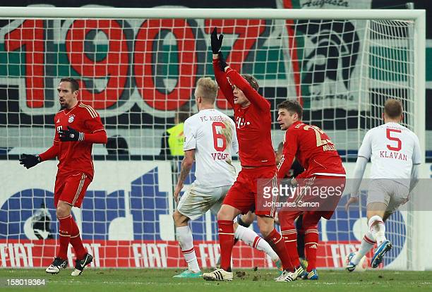 Toni Kroos of Bayern calls for handball during the Bundesliga match between FC Augsburg and FC Bayern Muenchen at SGL Arena on December 8 2012 in...