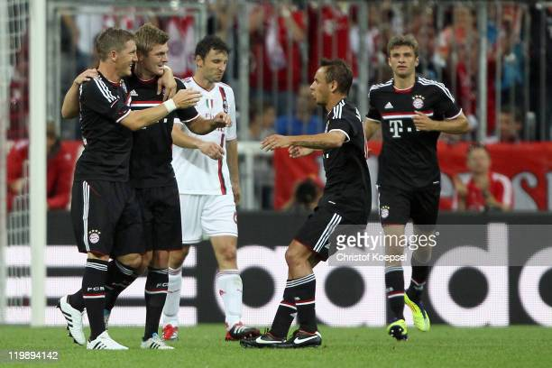 Toni Kroos of Bayern celebrates the first goal with Bastian Schweinsteiger Rafinha and Thomas Mueller during the Audi Cup match between FC Bayern...