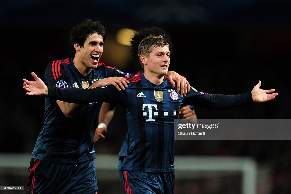 <a gi-track='captionPersonalityLinkClicked' href=/galleries/search?phrase=Toni+Kroos&family=editorial&specificpeople=638597 ng-click='$event.stopPropagation()'>Toni Kroos</a> of Bayern Muenchen celebrates scoring the opening goal with Javi Martinez of Bayern Muenchen during the UEFA Champions League Round of 16 first leg match between Arsenal and FC Bayern Muenchen at Emirates Stadium on February 19, 2014 in London, England.