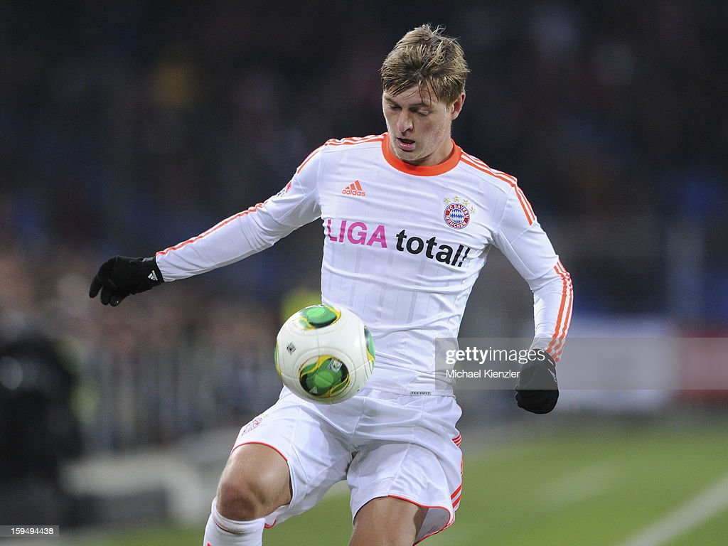 <a gi-track='captionPersonalityLinkClicked' href=/galleries/search?phrase=Toni+Kroos&family=editorial&specificpeople=638597 ng-click='$event.stopPropagation()'>Toni Kroos</a> of Bayern Munich stops ball during the friendly match between FC Basel and Bayern Munich at Stadium St. Jakob on January 12, 2013 in Basel, Switzerland.