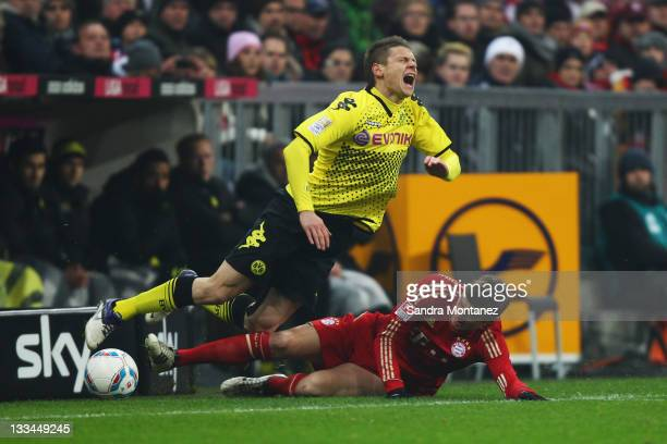 Toni Kroos of Bayern tackles Lukasz Piszczek of Dortmund during the Bundesliga match between FC Bayern Muenchen and Borussia Dortmund at Allianz...
