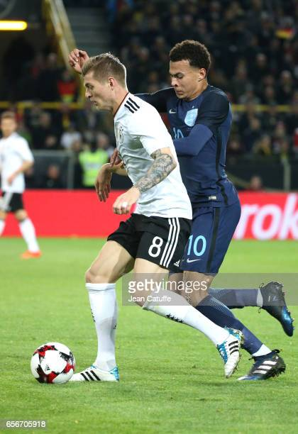 Toni Kroos of Germany and Dele Alli of England in action during the international friendly match between Germany and England at Signal Iduna Park on...