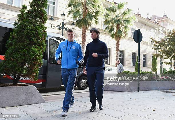 Toni Kroos of Germany and head coach Joachim Loew of Germany arrive for a press conference at the Hotel Ciudad de Vigo ahead of their International...
