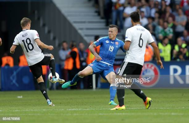 Toni Kroos of Germany and Juraj Kucka of Slovakia and Sami Khedira of Germany battle for the ball during the UEFA EURO 2016 round of 16 match between...