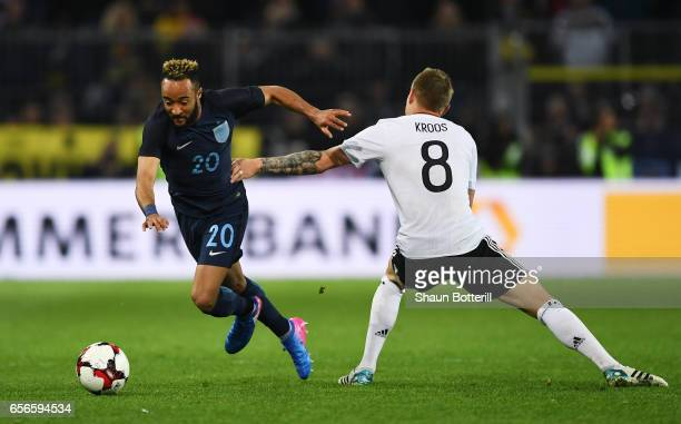 Toni Kroos of Germany attempts to stop Nathan Redmond of England during the international friendly match between Germany and England at Signal Iduna...
