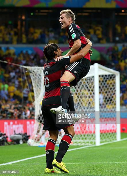 Toni Kroos of Germany celebrates scoring his team's fourth goal with his teammates Sami Khedira during the 2014 FIFA World Cup Brazil Semi Final...