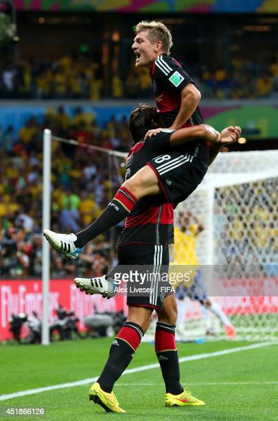 Toni Kroos of Germany celebrates scoring his team's fourth goal with his teammate Sami Khedira during the 2014 FIFA World Cup Brazil Semi Final match...