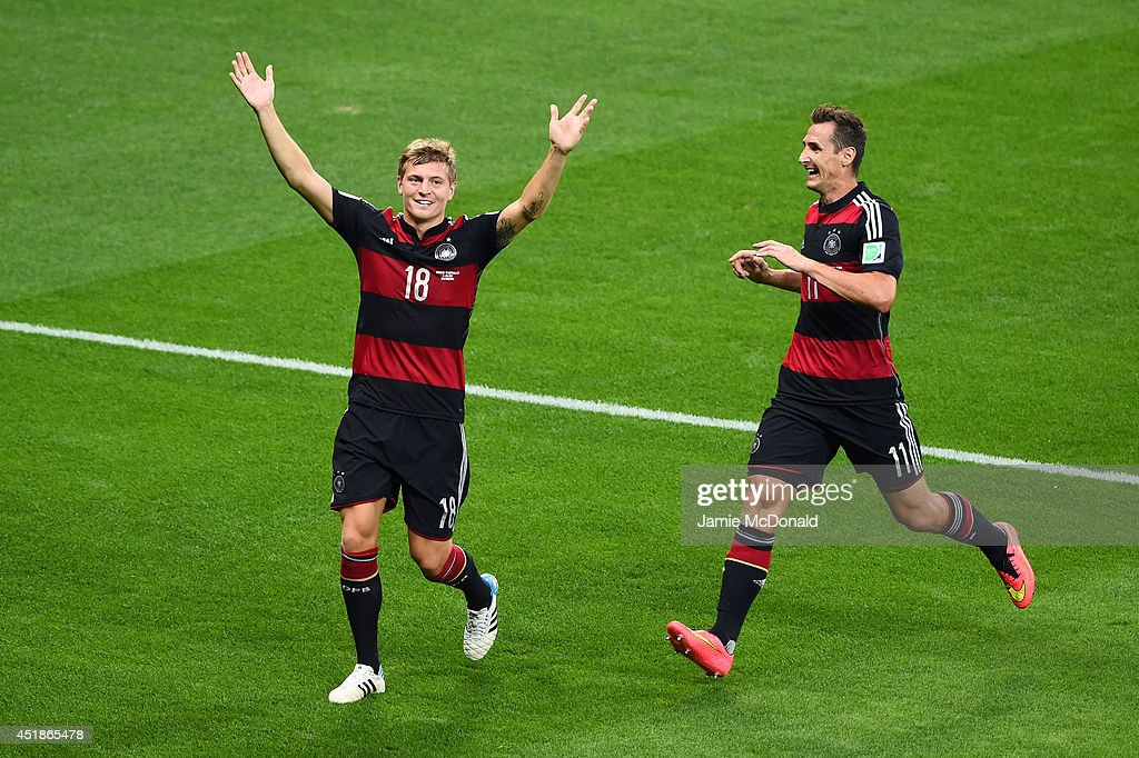 <a gi-track='captionPersonalityLinkClicked' href=/galleries/search?phrase=Toni+Kroos&family=editorial&specificpeople=638597 ng-click='$event.stopPropagation()'>Toni Kroos</a> of Germany (L) celebrates scoring his team's third goal with <a gi-track='captionPersonalityLinkClicked' href=/galleries/search?phrase=Miroslav+Klose&family=editorial&specificpeople=206489 ng-click='$event.stopPropagation()'>Miroslav Klose</a> during the 2014 FIFA World Cup Brazil Semi Final match between Brazil and Germany at Estadio Mineirao on July 8, 2014 in Belo Horizonte, Brazil.
